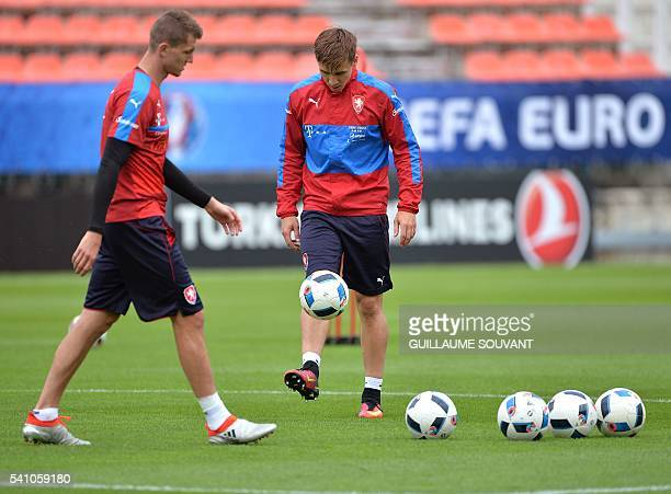 Czech Republic's forward Tomas Necid and Czech Republic's midfielder Josef Sural attends a training session of the national football team at their...