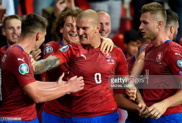 Czech Republic's forward Zdenek Ondrasek celebrates with teammates after scoring the 21 goal during the UEFA Euro 2020 qualifier Group A football...