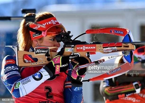 Czech Republic's Gabriela Koukalova shoots as she competes in the Biathlon World Cup Women's 125 km Mass Start race in Anterselva on January 21 2017...