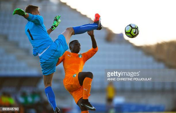 Czech Republic's goalkeeper Jan Plachy vies with Ivory Coast's Jean Thiery Lazare Amani during the Under 21 international football semi- final match...