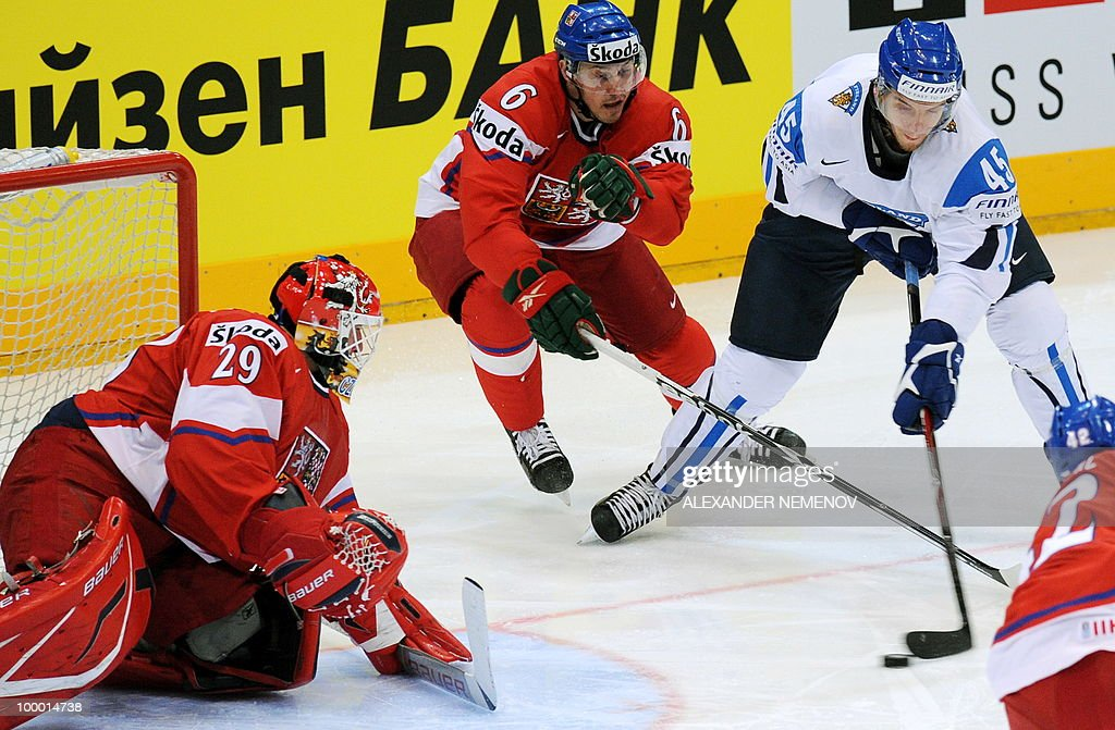 Czech Republic's goalkeeper Tomas Vokoun (L) of NHL's Florida Panthers defends his goal as Finland's Oskar Osala (R) vies with Czech Tomas Mojzis (C) during the IIHF Ice Hockey World Championship quarter-final match Finland vs Czech Republic in the western German city of Cologne on May 20, 2010. The 2010 IIHF Ice Hockey World Championships are taking place in Germany from May 7 to 23, 2010.
