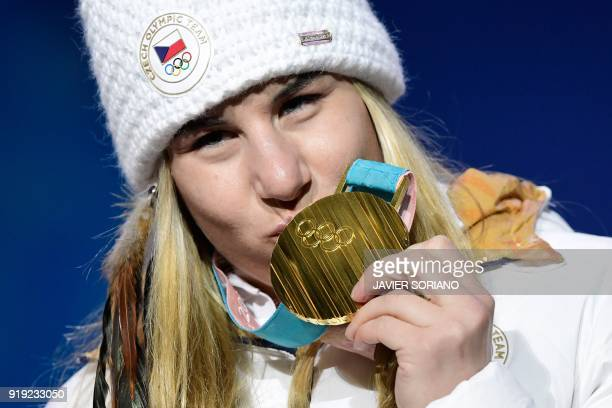 TOPSHOT Czech Republic's gold medallist Ester Ledecka kisses her medal on the podium during the medal ceremony for the alpine skiing women's SuperG...