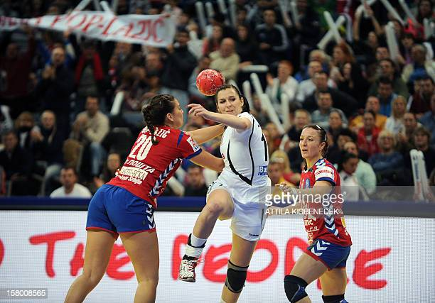 Czech Republic's Iveta Luzumova is pushed by Serbia's Sladana Pop–Lazic and Katarina Krpez during the 2012 EHF European Women's Handball Championship...