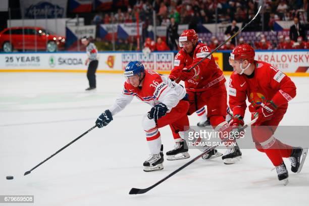 Czech Republic's Jakub Krejcik controls the puck during the IIHF Men's World Championship group B ice hockey match between Belarus and Czech Republic...