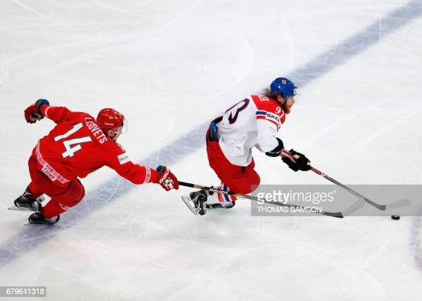 Czech Republic's Jakub Voracek challeges Belarus' Yevgeni Lisovets during the IIHF Men's World Championship group B ice hockey match between Belarus...