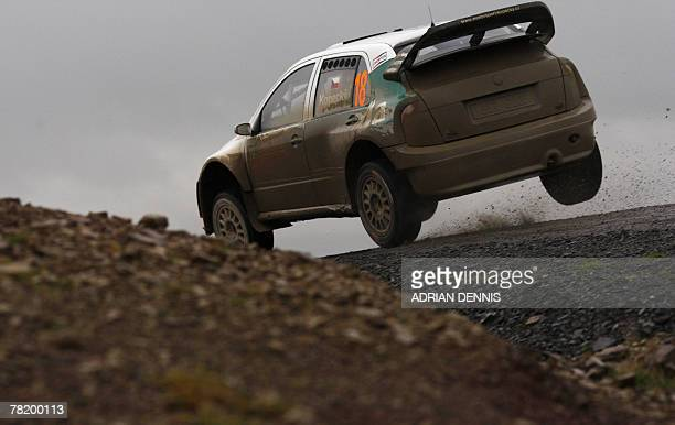 Czech Republic's Jan Kopecky drives a Skoda Fabia during Halfway 1 Stage 9 near Llandovery during the Wales Rally GB 01 December 2007 FInland's Mikko...
