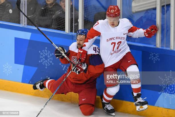 Czech Republic's Jan Kovar and Russia's Kirill Kaprizov collide in the men's semifinal ice hockey match between the Czech Republic and the Olympic...