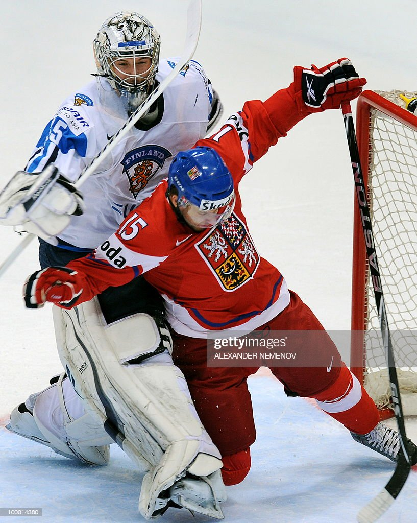 Czech Republic's Jan Marekvies (R) attacks Finland's goalkeeper Pekka Rinne of NHL's Nashville Predators during the IIHF Ice Hockey World Championship quarter-final match Finland vs Czech Republic in the western German city of Cologne on May 20, 2010. The 2010 IIHF Ice Hockey World Championships are taking place in Germany from May 7 to 23, 2010.