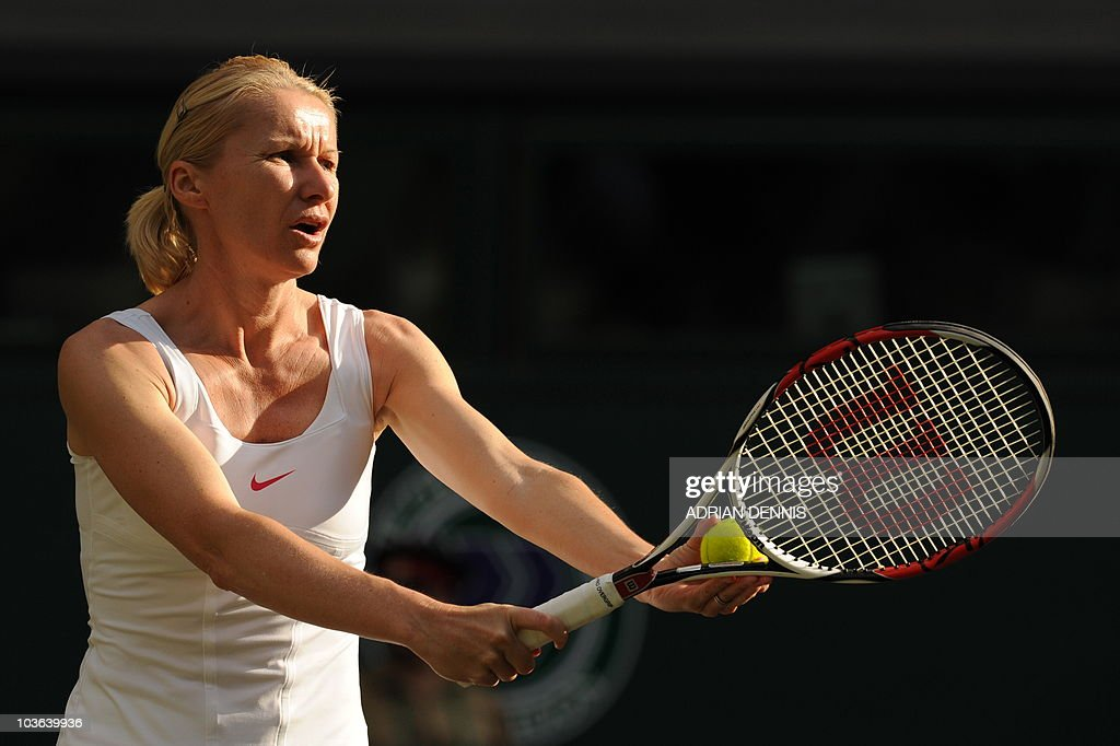 Czech Republic's Jana Novotna and unseen US martina Navratilova play during their ladies' invitation doubles match against South Africa's Ilana Kloss and US rosalyn Nideffer in the Wimbledon Tennis Championships at the All England Tennis Club, in southwest London on June 30, 2010.