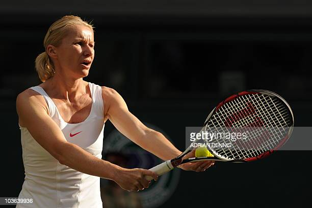 Czech Republic's Jana Novotna and unseen US martina Navratilova play during their ladies' invitation doubles match against South Africa's Ilana Kloss...