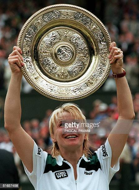 Czech Republic's Jana Novotna looks up at the ladies championship plate that she has coveted for so long following her 64 76 victory over Nathalie...