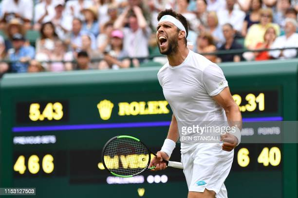 Czech Republic's Jiri Vesely celebrates beating Germany's Alexander Zverev during their men's singles first round match on the first day of the 2019...