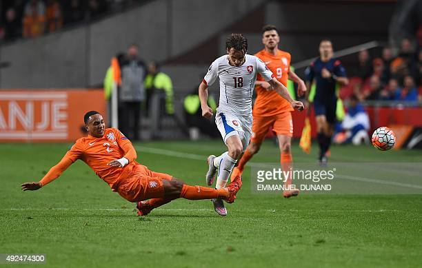 Czech Republic's Josef Sural is tackled by Netherlands' Kenny Tete during the Euro 2016 qualifying football match between The Netherlands vs Czech...
