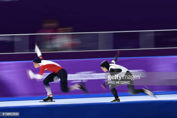 TOPSHOT Czech Republic's Karolina Erbanova and Japan's Nao Kodaira compete in the women's 500m speed skating event during the Pyeongchang 2018 Winter...