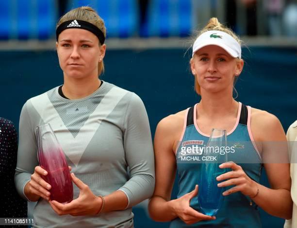 Czech Republic's Karolina Muchova and winner Switzerland's Jil Teichmann pose with their trophies after their final match at the WTA Prague tennis...