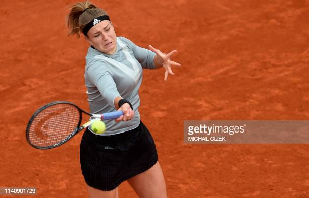 Czech Republic's Karolina Muchova returns the ball to US Bernarda Pera during their semifinal tennis match at the WTA Prague Open on May 3 2019 in...
