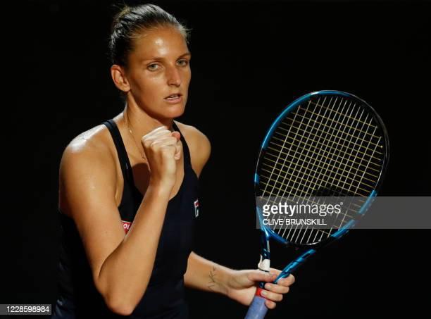 Czech Republic's Karolina Pliskova celebrates after defeating Belgium's Elise Mertens in their quarter final match of the Women's Italian Open at...