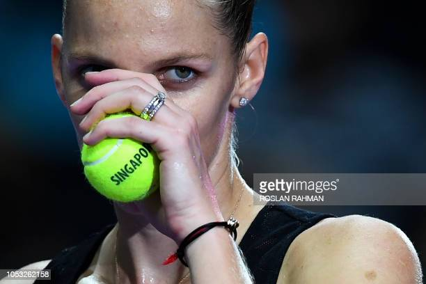 Czech Republic's Karolina Pliskova celebrates after defeating her compatriot Petra Kvitova during their singles match at the WTA Finals tennis...