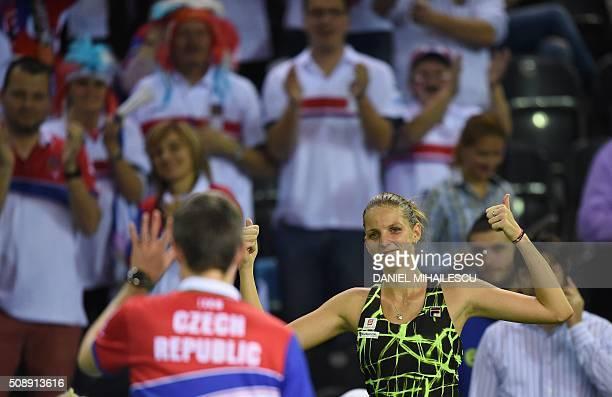 Czech Republic's Karolina Pliskova celebrates the victory against Romania's Monica Niculescu after the FedCup World Cup tennis match at 'Sala...