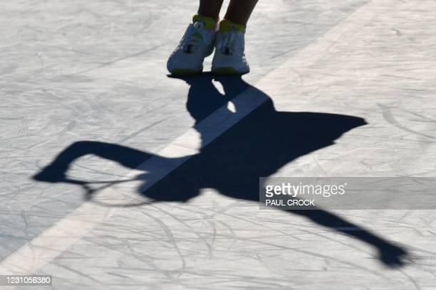 Czech Republic's Karolina Pliskova hits a return against Italy' Jasmine Paolini during their women's singles match on day two of the Australian Open...