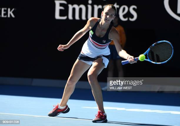 Czech Republic's Karolina Pliskova hits a return with her left hand against Romania's Simona Halep during their women's singles quarterfinals match...