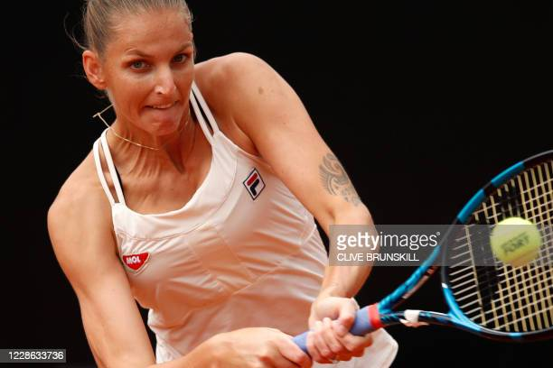 Czech Republic's Karolina Pliskova plays a backhand to Romania's Simona Halep during the final match of the Women's Italian Open at Foro Italico on...