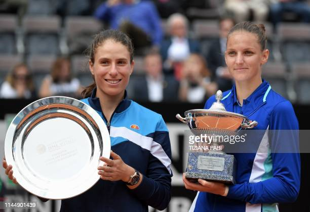 Czech Republic's Karolina Pliskova poses with the trophy after winning against Britain's Johanna Konta the WTA Masters tournament final tennis match...