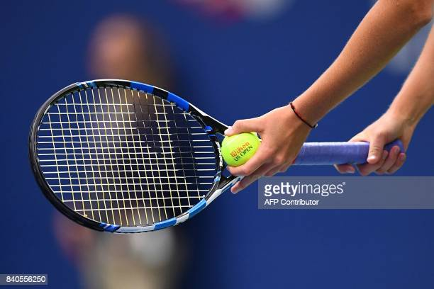 Czech Republic's Karolina Pliskova prepares to serve the ball to Poland's Magda Linette during their 2017 US Open Women's Singles match at the USTA...