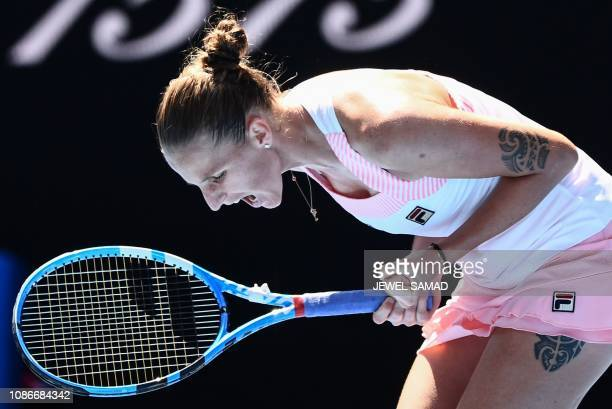 TOPSHOT Czech Republic's Karolina Pliskova reacts after a point against Serena Williams of the US during their women's singles quarterfinal match on...