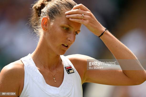 Czech Republic's Karolina Pliskova reacts against Belarus's Victoria Azarenka during their women's singles second round match on the third day of the...