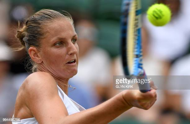 Czech Republic's Karolina Pliskova returns against Netherlands' Kiki Bertens during their women's singles fourth round match on the seventh day of...