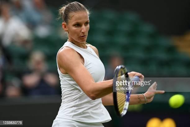 Czech Republic's Karolina Pliskova returns against Switzerland's Viktorija Golubic during their women's quarter-final tennis match on the eighth day...