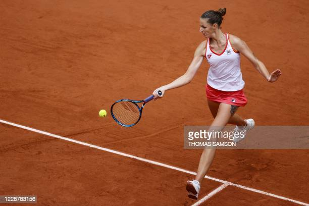 Czech Republic's Karolina Pliskova returns the ball to Egypt's Mayar Sherif during their women's singles first round tennis match on Day 3 of The...