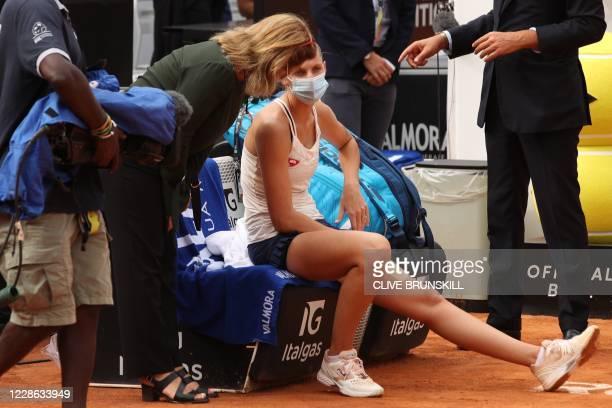 Czech Republic's Karolina Pliskova talks to Tournament Supervisor Giulia Orlandi after she pulled out following injury of the final match of the...