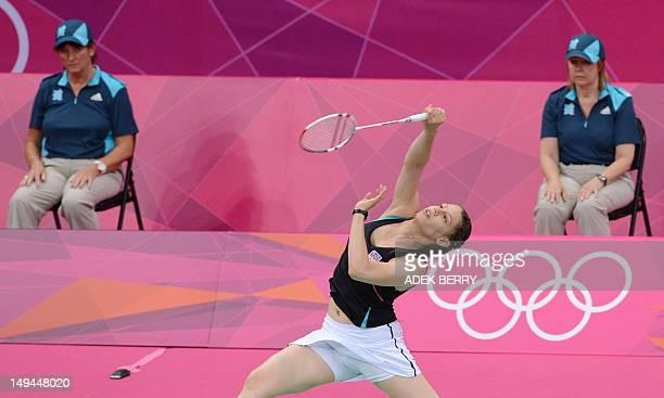 Czech Republic's Kristina Gavnholt returns a shuttle cock to Germany's Juliane Schenk during their women's singles badminton match during the London...
