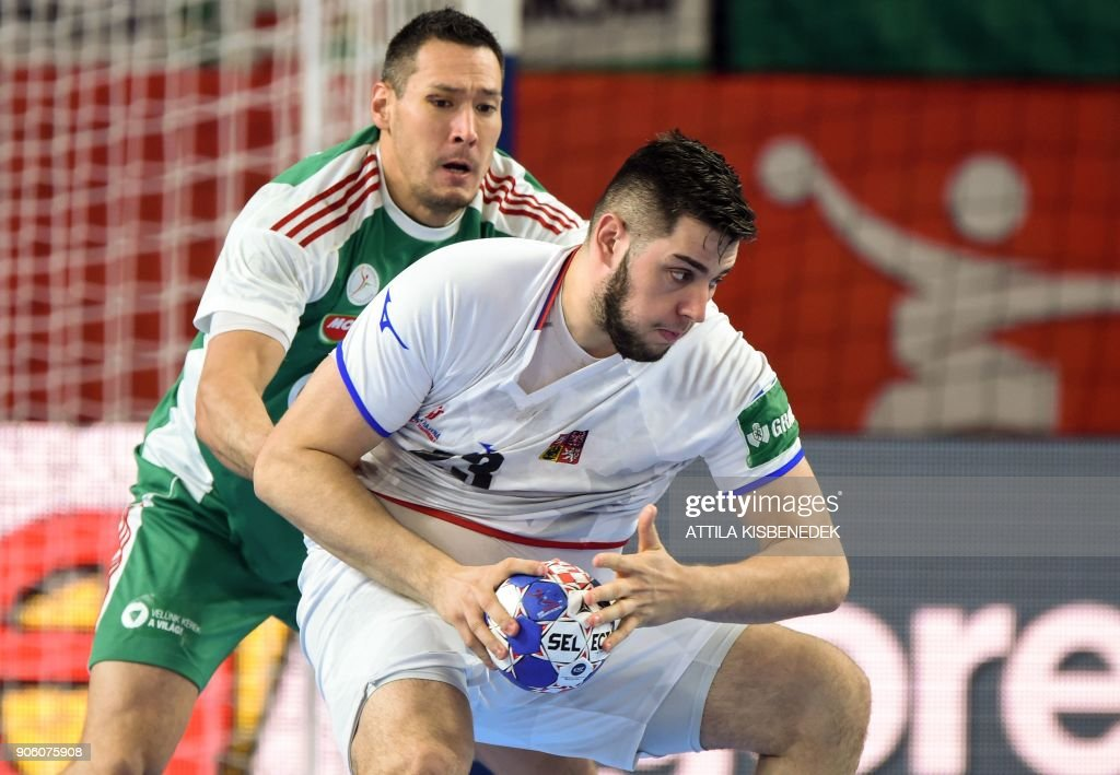 Czech Republic's Leos Petrovsky (Front) holds off Hungary's Timuzsin Schuch during the group D match of the Men's 2018 EHF European Handball Championships between Czech Republic and Hungary at the Varazdin Arena on January 17, 2018. / AFP PHOTO / Attila KISBENEDEK