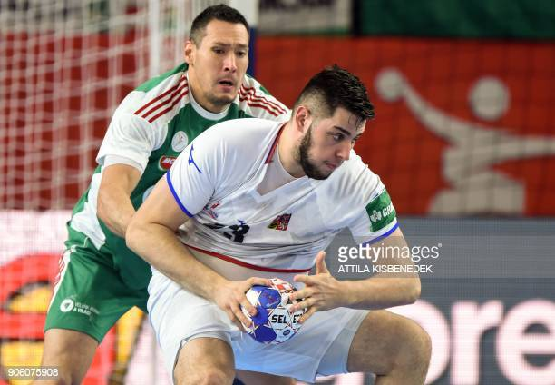 Czech Republic's Leos Petrovsky holds off Hungary's Timuzsin Schuch during the group D match of the Men's 2018 EHF European Handball Championships...
