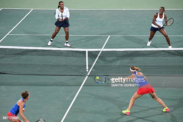 Czech Republic's Lucie Safarova and Czech Republic's Barbora Strycova return the ball to USA's Serena Williams and USA's Venus Williams during their...