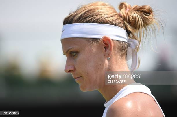 Czech Republic's Lucie Safarova reacts while playing Russia's Ekaterina Makarova in their women's singles third round match on the fifth day of the...