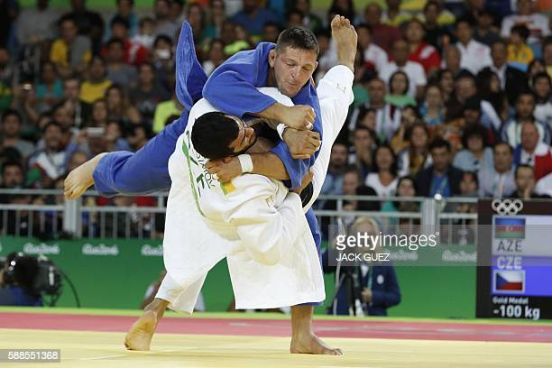 Czech Republic's Lukas Krpalek competes with Azerbaijan's Elmar Gasimov during their men's 100kg judo contest gold medal match of the Rio 2016...