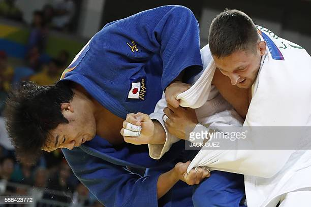 Czech Republic's Lukas Krpalek competes with Japan's Ryunosuke Haga during their men's 100kg judo contest quarterfinal match of the Rio 2016 Olympic...