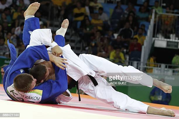 Czech Republic's Lukas Krpalek competes with Kazakhstan's Maxim Rakov during their men's 100kg judo contest match of the Rio 2016 Olympic Games in...
