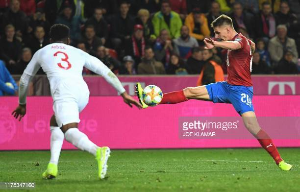 Czech Republic's Lukas Masopust and defender Danny Rose vie for the ball during the UEFA Euro 2020 qualifier Group A football match Czech Republic v...