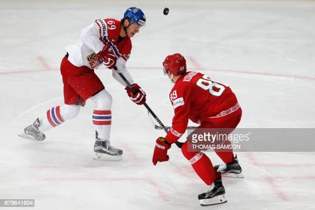 Czech Republic's Lukas Radil challenges Belarus' Dmitri Korobov during the IIHF Men's World Championship group B ice hockey match between Belarus and...