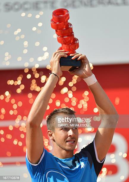 Czech Republic's Lukas Rosol lifts the trophy after he defeated Spain's Guillermo GarciaLopez during the final of the ATP tennis tournament in...
