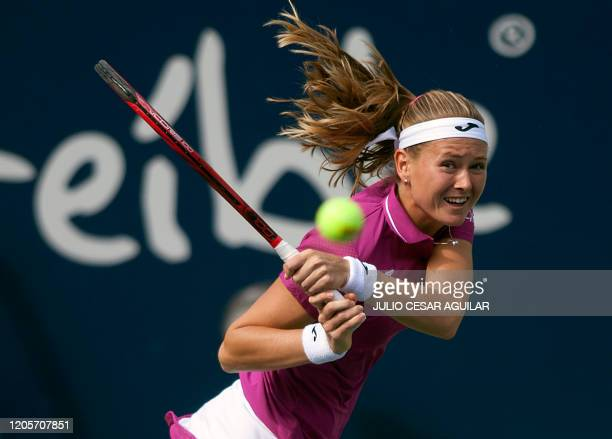 Czech Republic's Marie Bouzkova returns the ball to British Johanna Konta during their Monterrey WTA Open women's semifinal singles tennis match in...