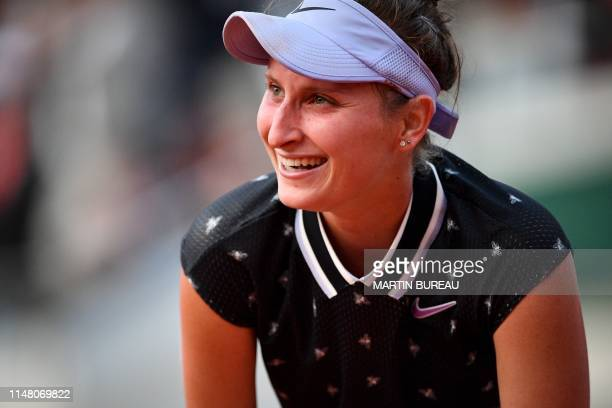 Czech Republic's Marketa Vondrousova celebrates after winning against Croatia's Petra Martic during their women's singles quarterfinal match on day...