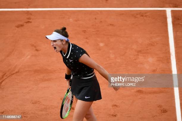 TOPSHOT Czech Republic's Marketa Vondrousova reacts after winning a point against Croatia's Petra Martic during their women's singles quarterfinal...