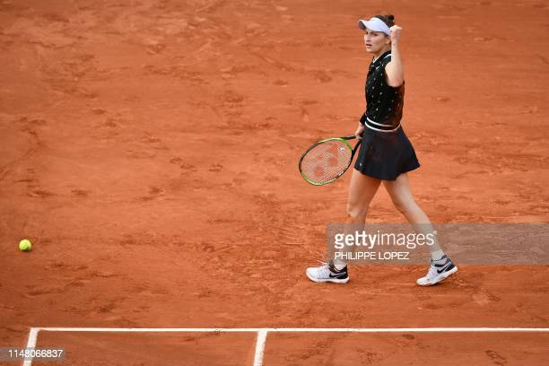 Czech Republic's Marketa Vondrousova reacts after winning a point against Croatia's Petra Martic during their women's singles quarterfinal match on...