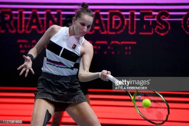 Czech Republic's Marketa Vondrousova returns the ball to Belgium's Alison Van Uytvanck during their final match at the WTA Hungarian Open Ladies'...